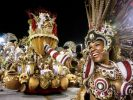 Photo: A Carnaval float and costumed woman